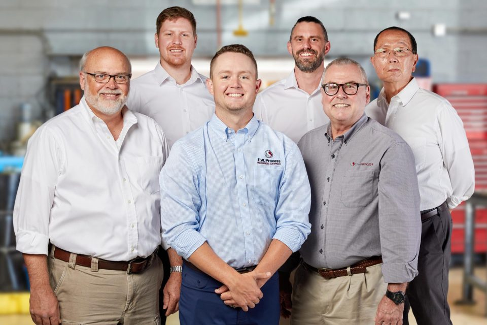 Group photo of male employees at MacGuire & Crawford instrumentation and control company