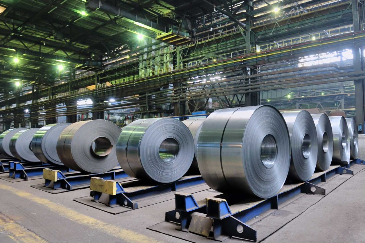 Rows of rolls of steel sheet in a large plant